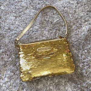 Micheal Kora gold sequin wristlet